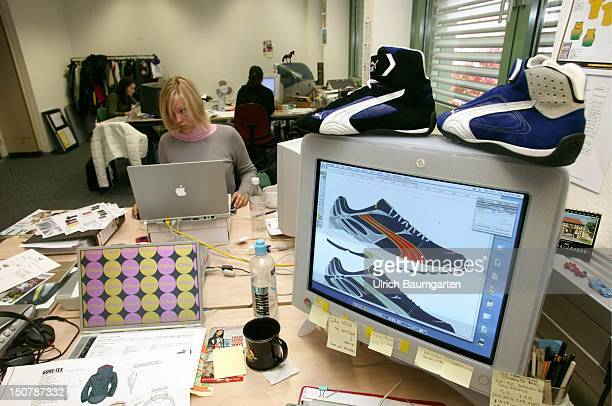 Design department of the Puma AG On the display the design of a sport shoe In the background a designer on the notebook