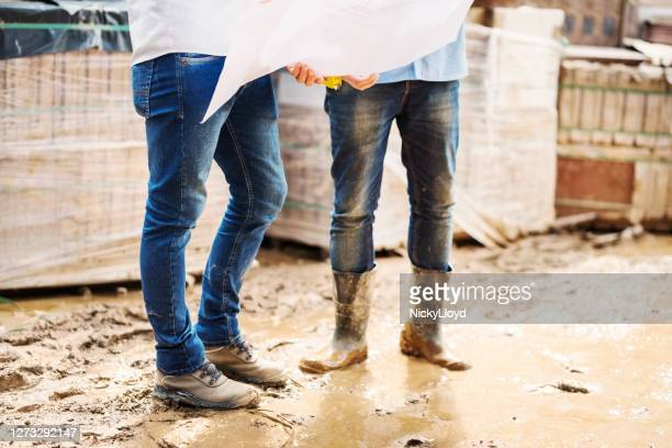 design engineers working on site - boot stock pictures, royalty-free photos & images