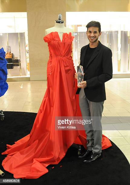 Design Lab Live Competition Winner Ali Jawad and winning gown at Westfield Style Hosts Cocktails Couture at Westfield Topanga on November 13 2014 in...