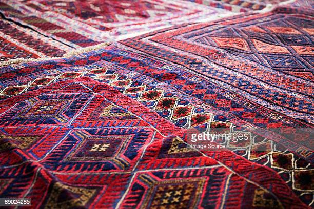 design on rug in market - persian rug stock photos and pictures
