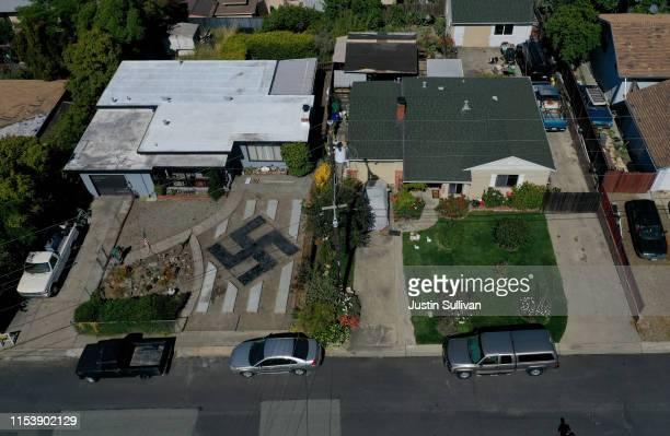A design resembling a swastika is displayed in front of a home on June 05 2019 in El Sobrante California People living in a San Francisco Bay Area...