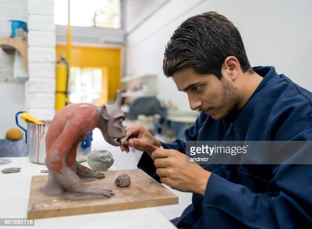 Design student at the university in a pottery class