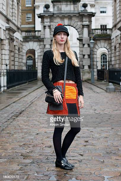Design Student Laura Tonder wears Sonia by Sonia Rykiel shoes her own design skirt vintage top Gucci bag and Costo hat on day 2 of London Fashion...