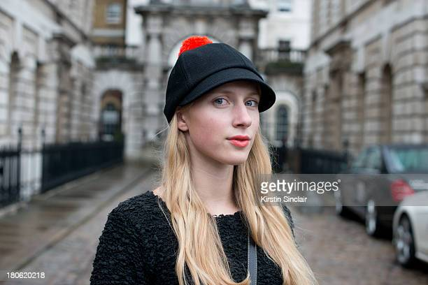Design Student Laura Tonder wears vintage top and a Costo hat on day 2 of London Fashion Week Spring/Summer 2013 at Somerset House on September 14...