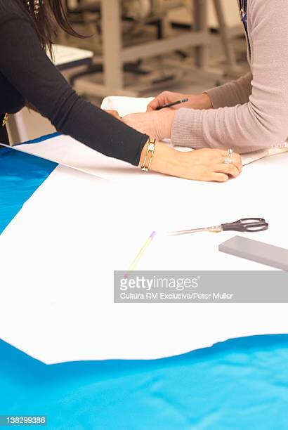 Design students cutting fabric