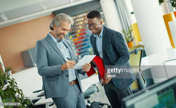 design studio executives in a meeting. - creative director stock pictures, royalty-free photos & images