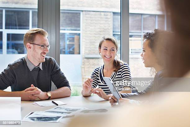 design team meeting at conference table in creative office - leanintogether stock pictures, royalty-free photos & images