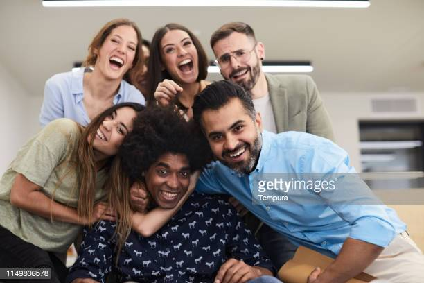 design team portrait in their studio. - admiration stock pictures, royalty-free photos & images