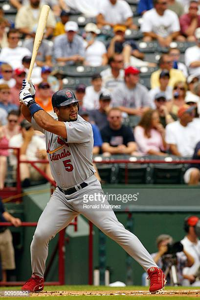 Designated hitter Albert Pujols of the St Louis Cardinals bats against the Texas Rangers at Ameriquest Field on June 13 2004 in Arlington in...