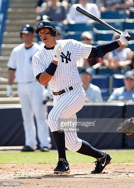 Designated hitter Alex Rodriguez of the New York Yankees follows through as he hits a single to left field off of pitcher Kevin Slowey of the...