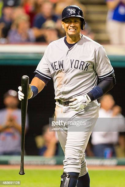 Designated hitter Alex Rodriguez of the New York Yankees reacts after striking out to end the top of the ninth inning against the Cleveland Indians...
