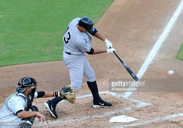 Designated hitter Alex Rodriguez of the Tampa Yankees doubles in the third inning against the Dunedin Blue Jays August 12 2011 at Florida Auto...