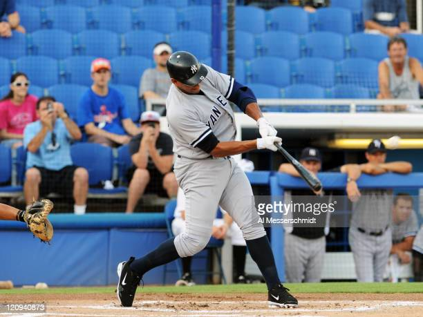 Designated hitter Alex Rodriguez of the Tampa Yankees homers in his first at bat against the Dunedin Blue Jays August 12 2011 at Florida Auto...