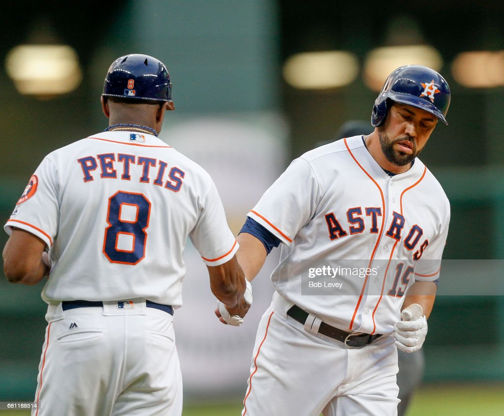 Designated hitter Carlos Beltran #15 of the Houston Astros receives congratulations from third base coach Gary Pettis #8 after a first inning home run against the Atlanta Braves at Minute Maid Park on May 9, 2017 in Houston, Texas.
