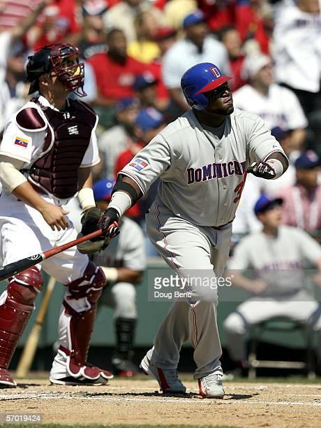 Designated hitter David Ortiz of Dominican Republic and catcher Ramon Hernandez of Venezuela follow the flight of Ortiz' home run in the second...