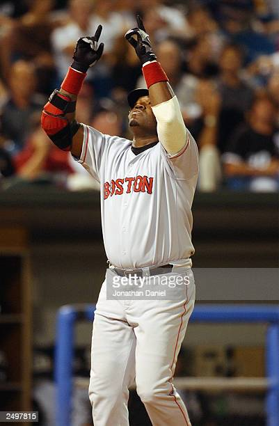 Designated hitter David Ortiz of the Boston Red Sox celebrates a tworun home run in the eighth inning against the Chicago White Sox during a game on...