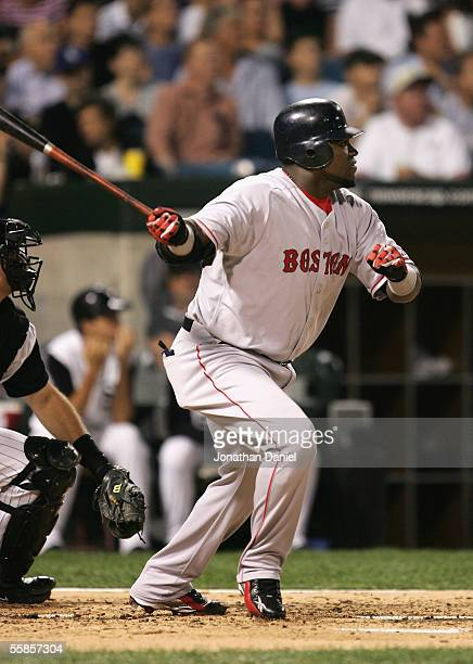 Designated hitter David Ortiz of the Boston Red Sox hits a double against the Chicago White Sox during the third inning of Game Two of the American...