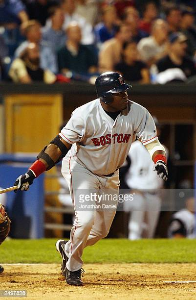 Designated hitter David Ortiz of the Boston Red Sox hits the game winning home run in the tenth inning against the Chicago White Sox during a game on...