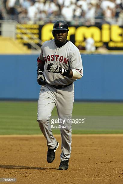 Designated hitter David Ortiz of the Boston Red Sox rounds the bases after hitting a solo home run in the seventh inning against the New York Yankees...