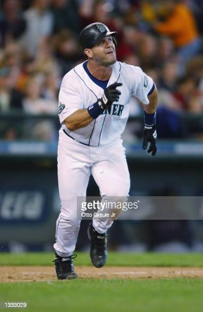 Designated hitter Edgar Martinez of the Seattle Mariners watches the flight of the ball during the MLB game against the Cleveland Indians on August 4...