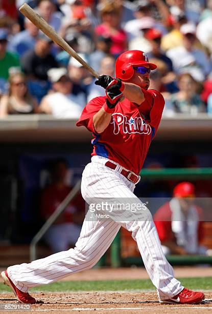 Designated hitter Greg Dobbs of the Philadelphia Phillies fouls off a pitch against the Detroit Tigers during a Grapefruit League Spring Training...
