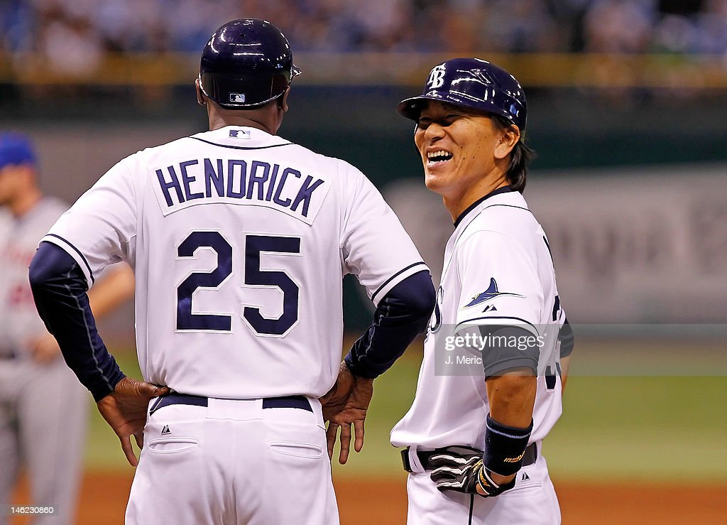 Designated hitter Hideki Matsui #35 of the Tampa Bay Rays shares a laugh with first base coach George Hendrick #25 during the game against the New York Mets at Tropicana Field on June 12, 2012 in St. Petersburg, Florida.