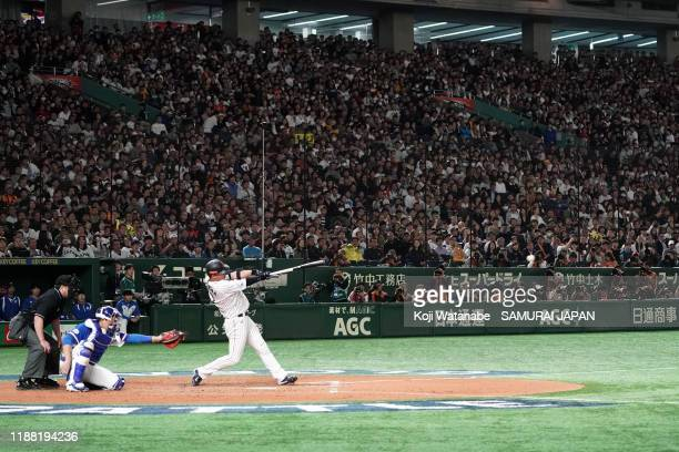 Designated hitter Hideto Asamura of Japan hits a RBI single in the bottom of 7th inning during the WBSC Premier 12 final game between Japan and South...