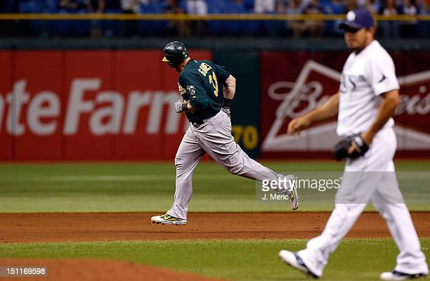Designated hitter Jonny Gomes of the Oakland Athletics rounds the bases after his two run home run against the Tampa Bay Rays in the eighth inning...