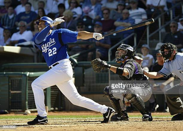 Designated hitter Juan Gonzalez of the Kansas City Royals hits against the Colorado Rockies on March 7 2004 at Surprise Stadium in Surprise Arizona