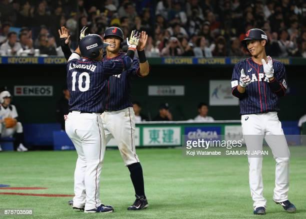 Designated hitter Kensuke Kondo Infielder Shogo Nakamura and Infielder Ryoma Nishikawa of Japan celebrate after Infielder Go Matsumoto hitting two...