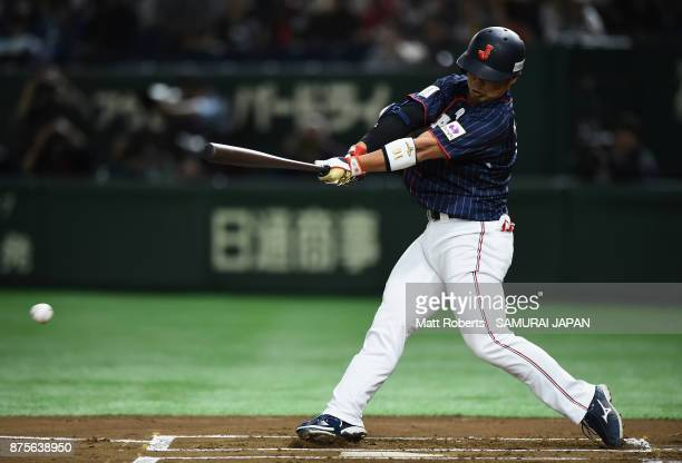 Designated hitter Kensuke Kondo of Japan grounds out in the top of first inning during the Eneos Asia Professional Baseball Championship 2017 game...