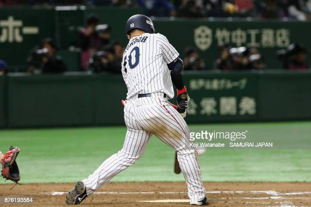 Designated hitter Kensuke Kondo of Japan hits a double in the bottom of sixth inning during the Eneos Asia Professional Baseball Championship 2017...