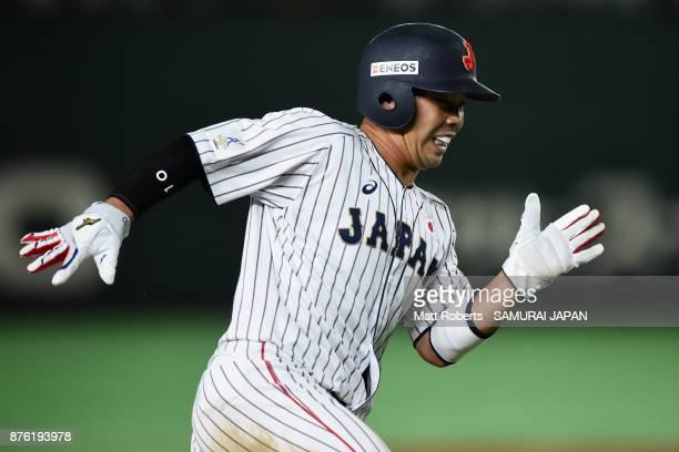 Designated hitter Kensuke Kondo of Japan runs to score a run by the two run single of Infielder Hotaka Yamakawa in the bottom of sixth inning during...