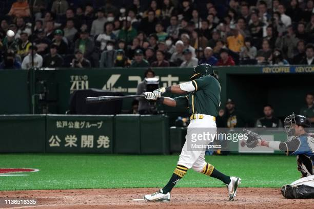 Designated hitter Khris Davis of the Oakland Athletics hits a three run homer to make it 66 in the top of 9th inning during the preseason friendly...