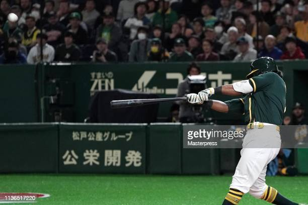 Designated hitter Khris Davis of the Oakland Athletics hits a three run homer to make it 6-6 in the top of 9th inning during the preseason friendly...
