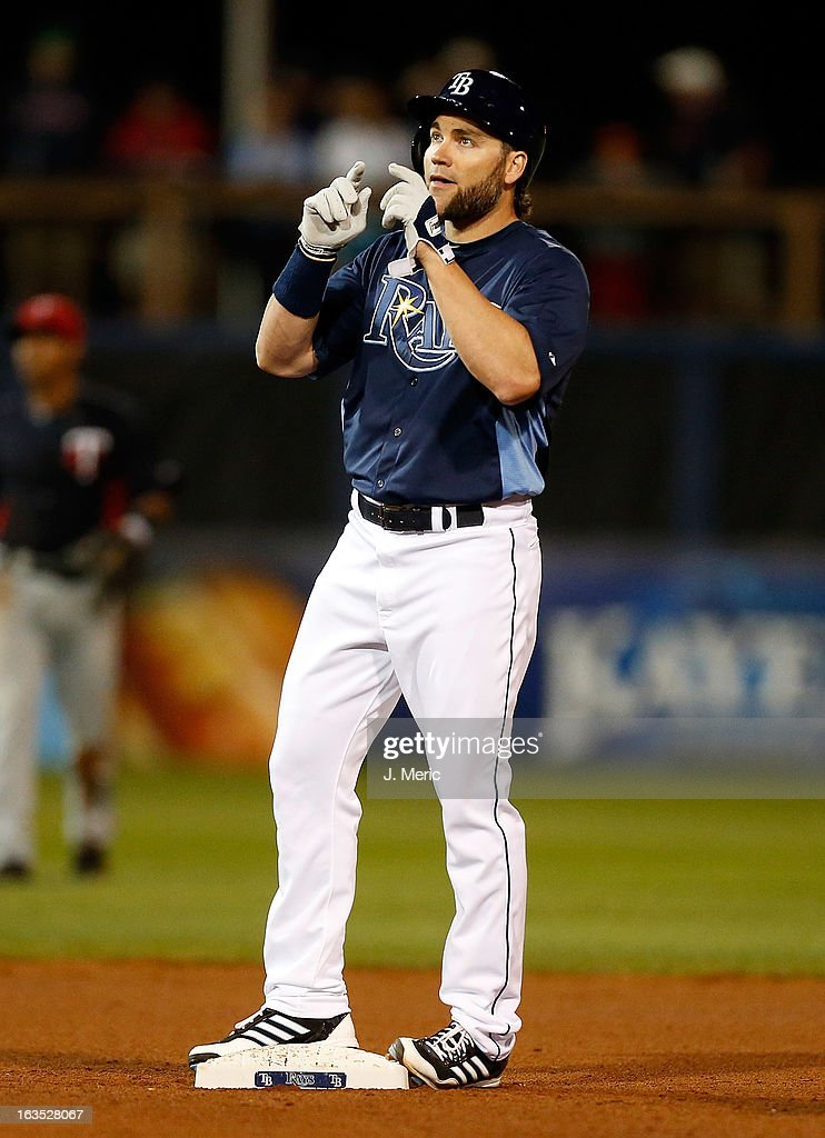 Designated hitter Luke Scott #30 of the Tampa Bay Rays celebrates his double against the Minnesota Twins during a Grapefruit League spring training game at the Charlotte Sports Complex on March 11, 2013 in Port Charlotte, Florida.