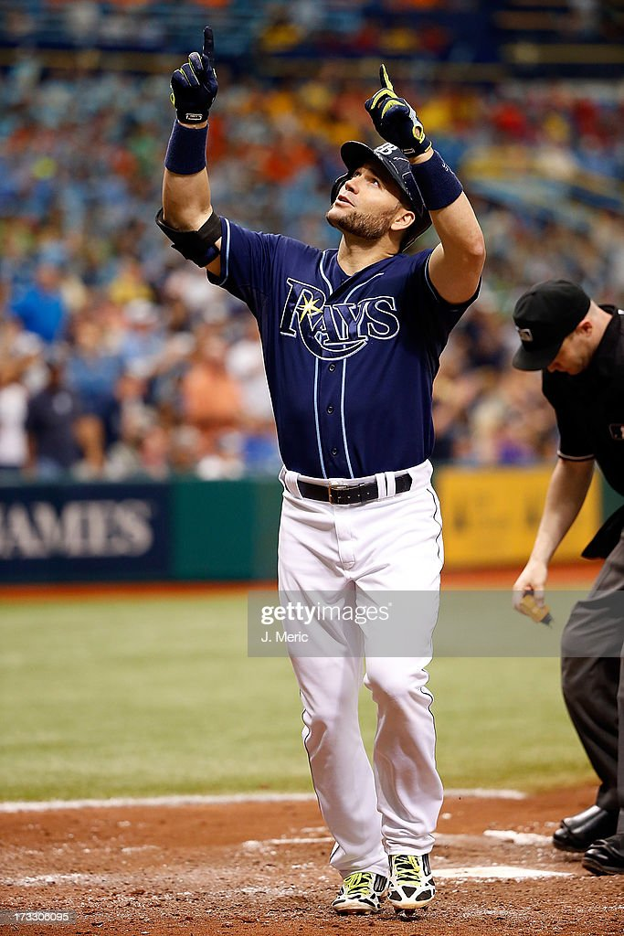 Designated hitter Luke Scott #30 of the Tampa Bay Rays celebrates his solo sixth inning home run against the Minnesota Twins during the game at Tropicana Field on July 11, 2013 in St. Petersburg, Florida.