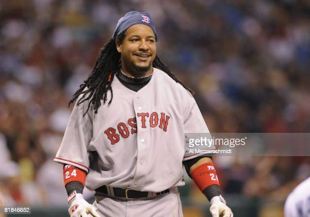 Designated hitter Manny Ramirez of the Boston Red Sox smiles after ducking from an inside pitch against the Tampa Bay Rays July 2 2008 at Tropicana...