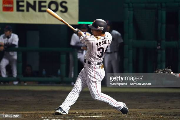 Designated hitter Masataka Yoshida hits a RBI double in the bottom of 4th inning to make it 6-1 during the game one between Samurai Japan and Canada...