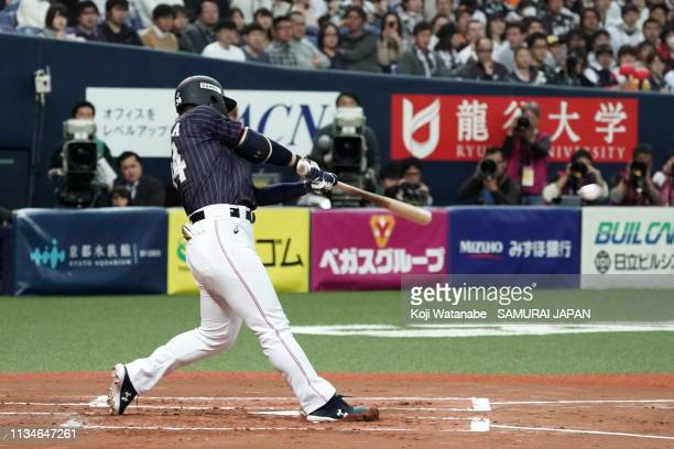 Designated hitter Masataka Yoshida of Japan hits a RBI single in the top of 1st inning during the game one between Japan and Mexico at Kyocera Dome...