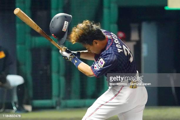 Designated hitter Masataka Yoshida of Japan nearly bieing hit by pitch in the top of 6th inning during the game two between Samurai Japan and Canada...