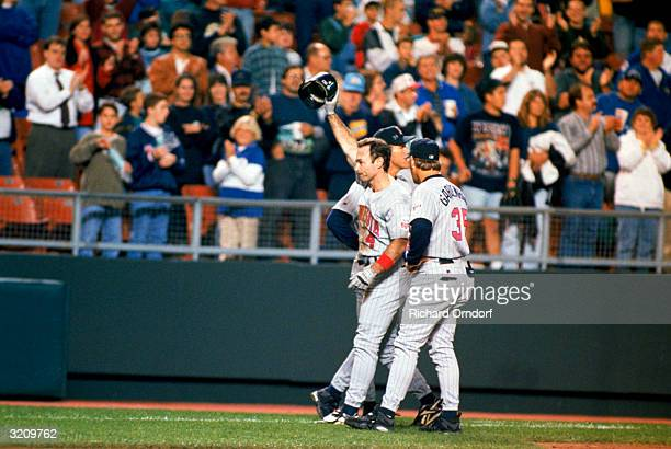 Designated hitter Paul Molitor of the Minnesota Twins celebrates with teammates after he got his 3000th hit during the game against the Kansas City...