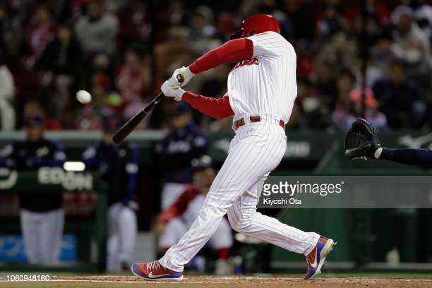 Designated hitter Rhys Hoskins of the Philadelphia Phillies hits a solo homer to make it 10 in the bottom of 2nd inning during the game four between...