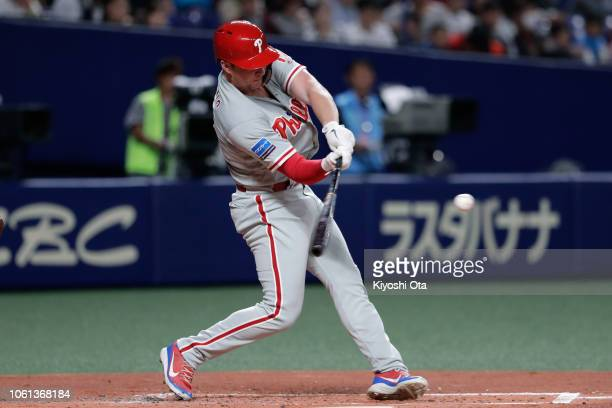 Designated hitter Rhys Hoskins of the Philadelphia Phillies hits a two-run home run in the top of 2nd inning during the game five between Japan and...