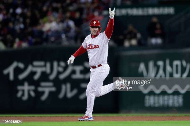 Designated hitter Rhys Hoskins of the Philadelphia Phillies celebrates hitting a solo homer to make it 10 in the bottom of 2nd inning during the game...