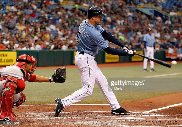 Designated hitter Rocco Baldelli of the Tampa Bay Rays fouls off a pitch against the Los Angeles Angels of Anaheim during the game at Tropicana Field...