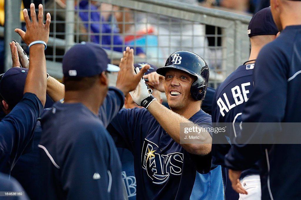 Designated hitter Shelley Duncan #64 of the Tampa Bay Rays is congratulated after his home run against the Pittsburgh Pirates during a Grapefruit League Spring Training Game at the Charlotte Sports Complex on March 25, 2013 in Port Charlotte, Florida.