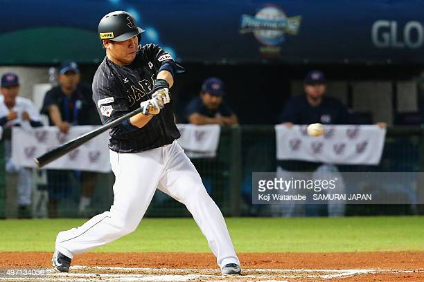 Designated hitter Takeya Nakamura of Japan hits a single in the top of sixth inning during the WBSC Premier 12 match between the United States and...