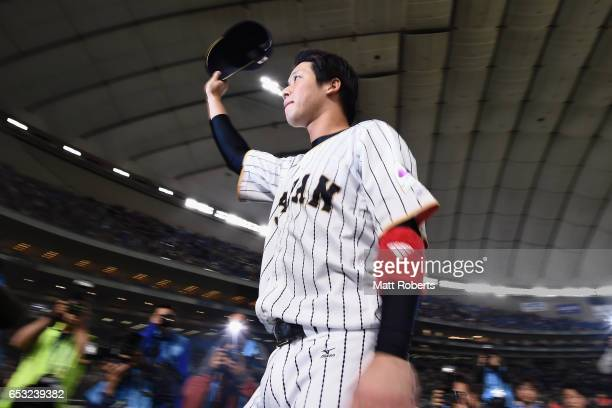 Designated hitter Tetsuto Yamada of Japan applauds fans after his team's 58 victory in the World Baseball Classic Pool E Game Four between Cuba and...