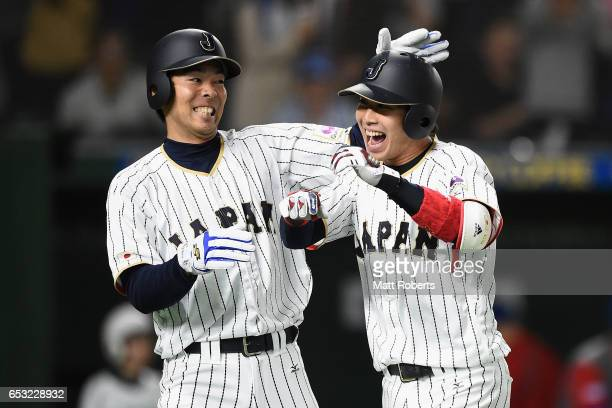 Designated hitter Tetsuto Yamada of Japan celebrates with Outfielder Shogo Akiyama after hitting a two run homer to make it 58 in the bottom of the...